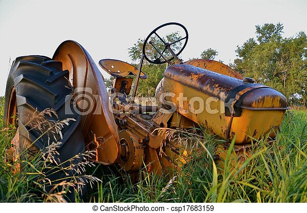 Yellow Tractor in the Weeds