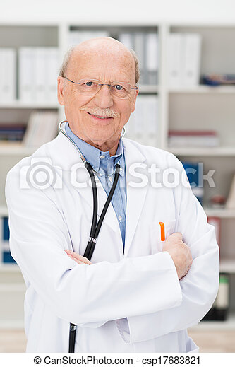 Friendly elderly male doctor in his office - csp17683821