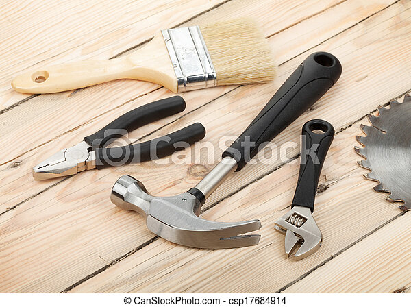 Set of tools on wood background - csp17684914