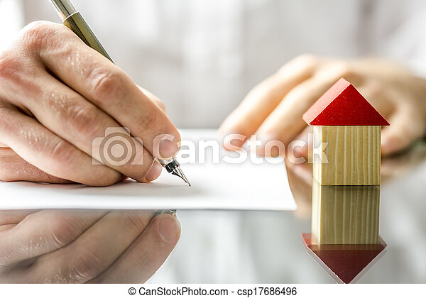 Man signing a contract when buying a new house - csp17686496