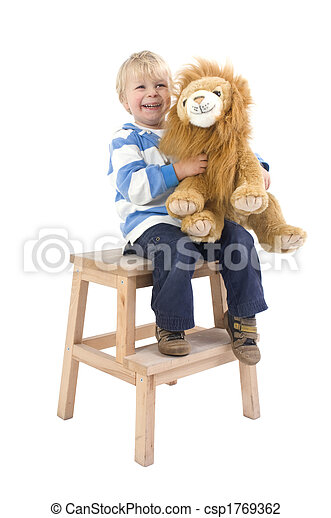 Boy with toy lion on a stool - csp1769362