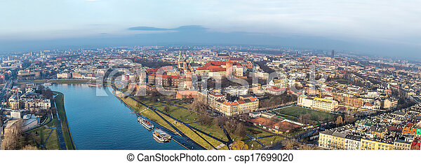Historic royal Wawel castle in Cracow, Poland with park and Vistula river. Aerial view at sunset. - csp17699020