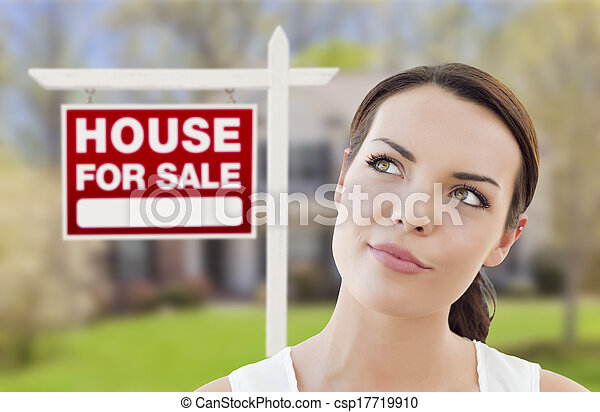 Thinking Woman In Front of House and For Sale Sign - csp17719910