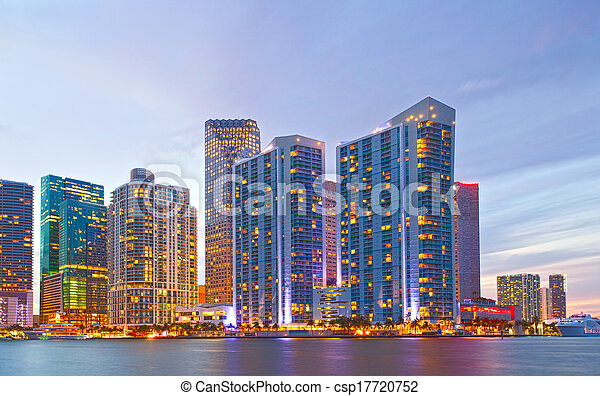City of Miami Florida, night skyline. Cityscape of residential and business buildings illuminated at sunset - csp17720752