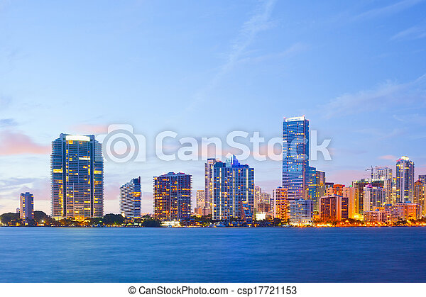 City of Miami Florida, colorful night panorama of downtown business and residential buildings - csp17721153