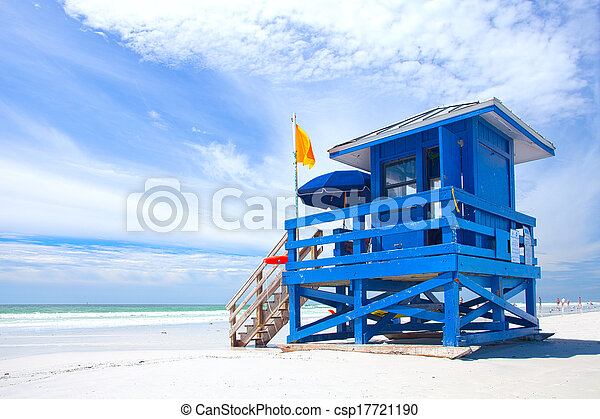Siesta Key Beach, Florida USA, colorful lifeguard house on a beautiful summer day with ocean and blue cloudy sky - csp17721190