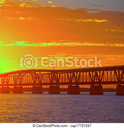 Colorful landscape of a beautiful tropical sunset or sunrise. Taken at Bahia Honda Key State Park in Florida. Old Flagler Bridge remains as a tourist landmark and a monument to a hurricane.  - csp17721247