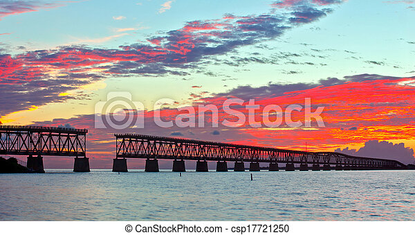 Colorful landscape of a beautiful tropical sunset or sunrise. Taken at Bahia Honda Key State Park in Florida. Old Flagler Bridge remains as a tourist landmark and a monument to a hurricane.  - csp17721250