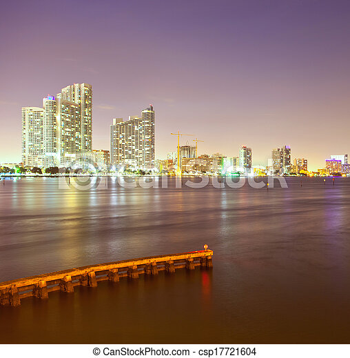 City of Miami Florida, night skyline. Cityscape of residential and business buildings illuminated at sunset - csp17721604
