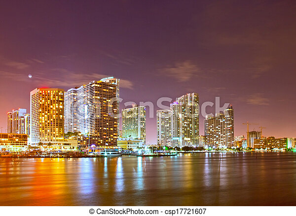 City of Miami Florida, night skyline. Cityscape of residential and business buildings illuminated at sunset - csp17721607