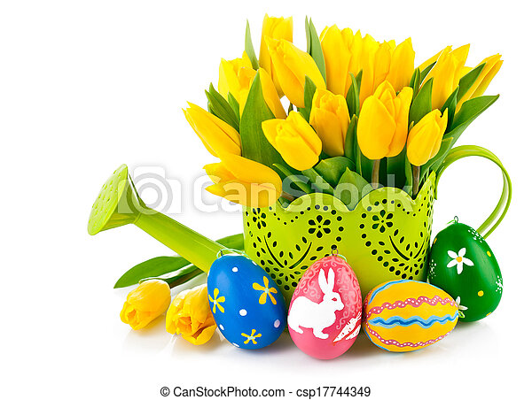 easter eggs with yellow tulips in watering can - csp17744349
