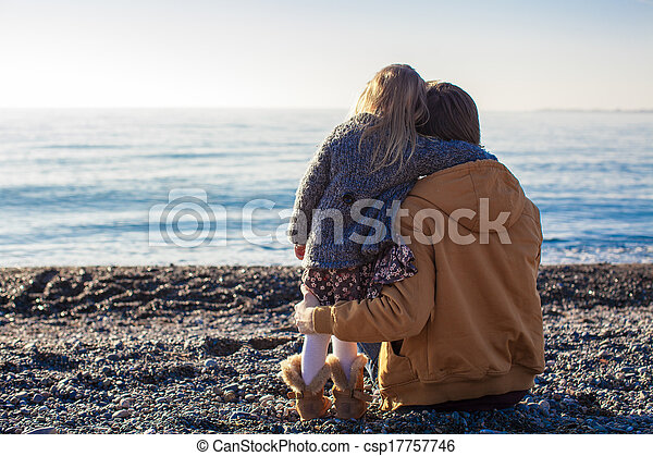 Back view of Young father and little girl at the beach on a sunny winter day - csp17757746