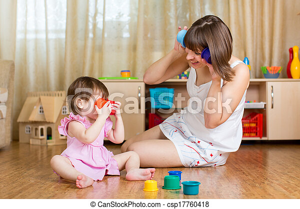 child and her mother playing together with toys - csp17760418