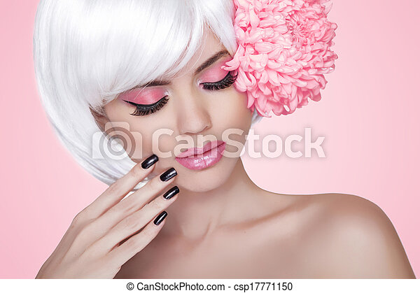 Makeup. Manicured nails. Fashion Beauty Model Girl portrait with Flower. Treatment. Beautiful Blonde Woman over pink background