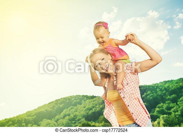 happy family. mother and daughter baby girl playing on nature - csp17772524