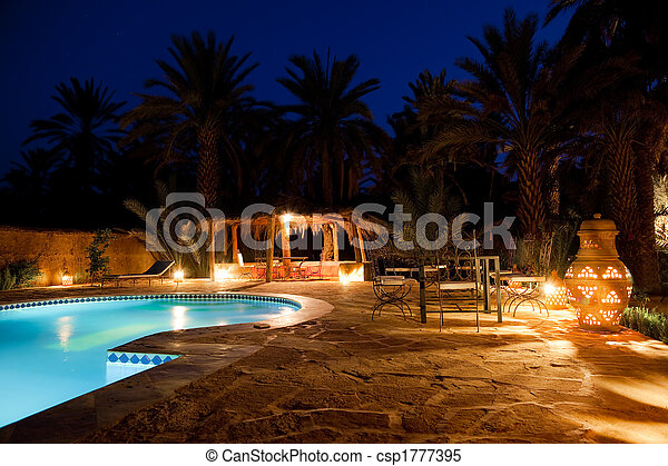 Arab hotel pool evening - csp1777395