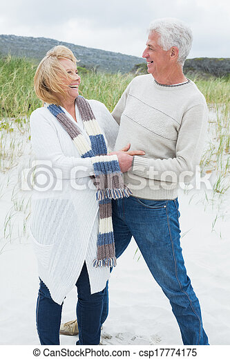 Cheerful romantic senior couple at beach - csp17774175