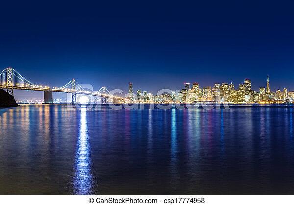 San Francisco sunset skyline California bay water reflection - csp17774958