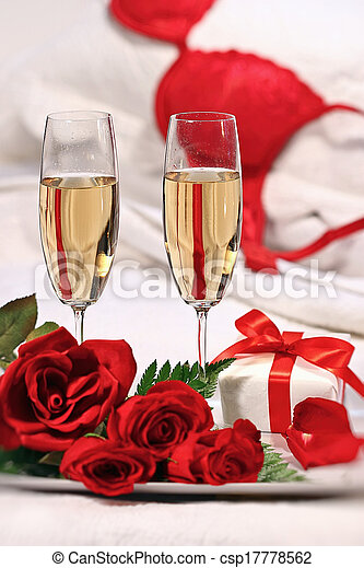 stock image of champagne glasses and roses to celebrate