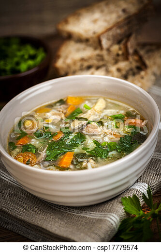 Chicken soup with rice and vegetables - csp17779574
