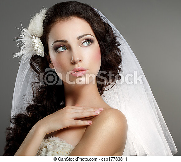 Wedding. Young Gentle Quiet Bride in Classic White Veil Looking Away - csp17783811