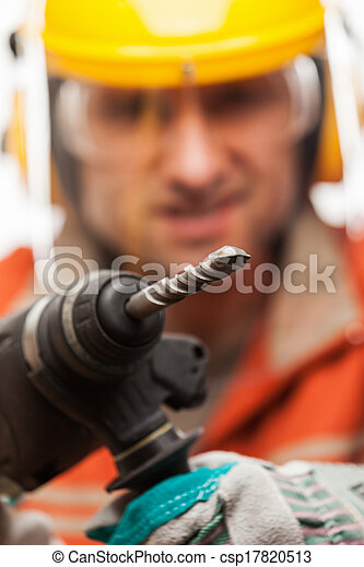 Construction building engineer or manual worker man in safety hardhat helmet hand holding electric hammer drill tool white isolated - csp17820513