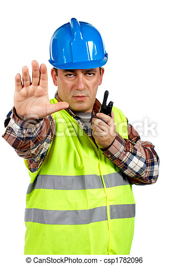 Construction worker with green safety vest worker talking with a walkie talkie and orders to stop. Hand on focus - csp1782096