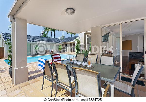 entertainment area outside of modern australian home - csp17834725