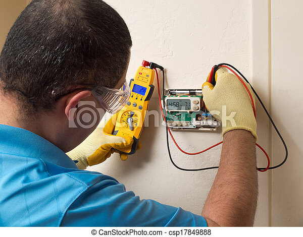 Hispanic handyman repairman conducting residential HVAC repair - csp17849888