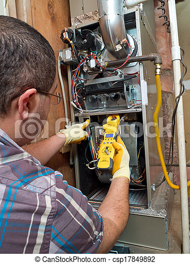 Hispanic handyman repairman conducting residential HVAC repair - csp17849892