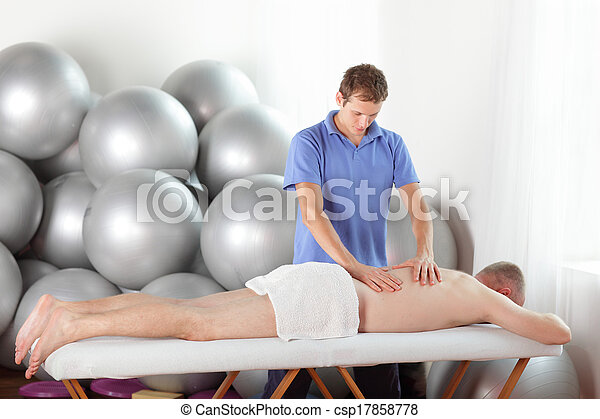 therapist massaging man - csp17858778
