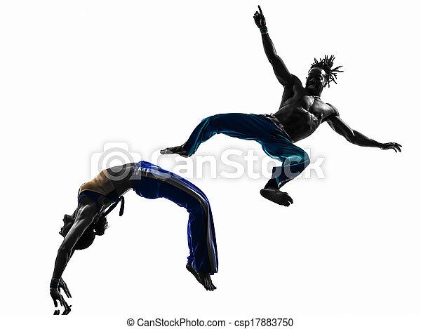 couple capoeira dancers dancing   silhouette  - csp17883750