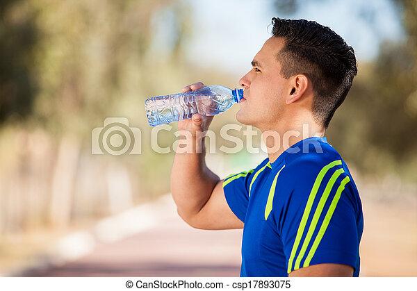 Taking a water break after a run
