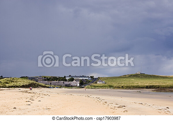 Low Newton by the Sea with heavy clouds - csp17903987