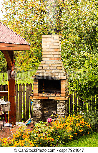 Brick grill placed in a garden - csp17924047