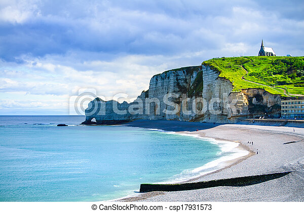 Etretat cliff and church landmark and its beach on morning. Normandy, France, Europe. - csp17931573