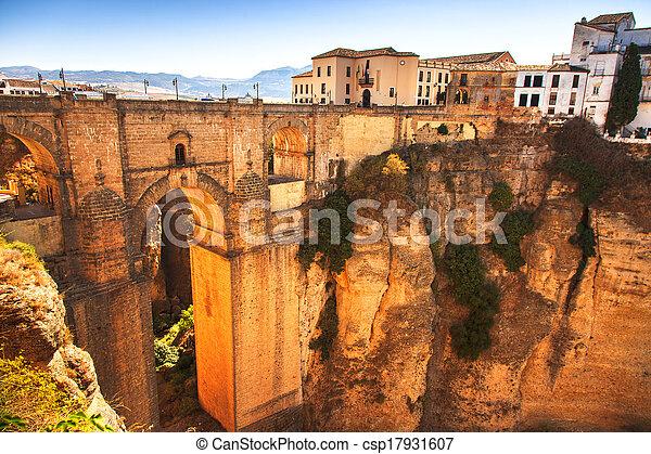 Puente Nuevo or New Bridge historic landmark and el tajo gorge in Ronda, white village building on the rocks. Andalusia, Spain. - csp17931607