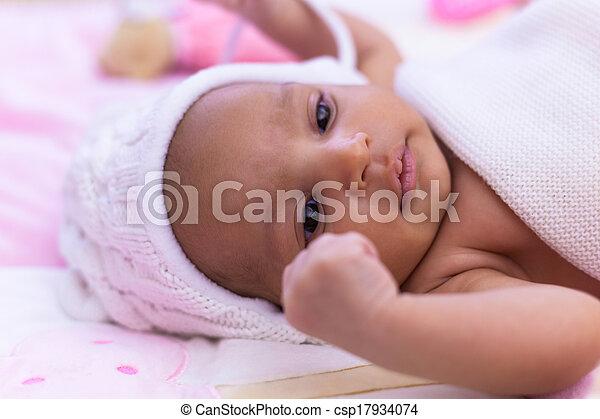 Adorable little african american baby girl looking - Black people - csp17934074