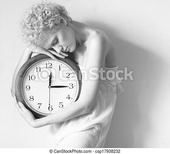 Young woman with big clock in hands, black and white photo.