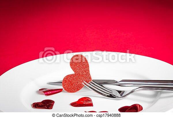valentine day dinner on red background - csp17940888