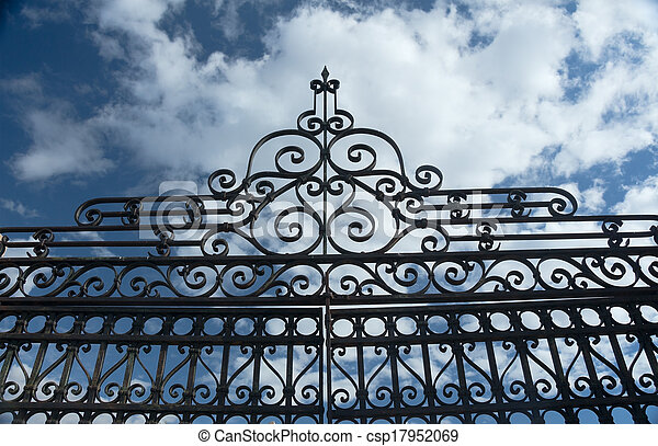 Old Wrought Iron Fence and Blue Sky - csp17952069