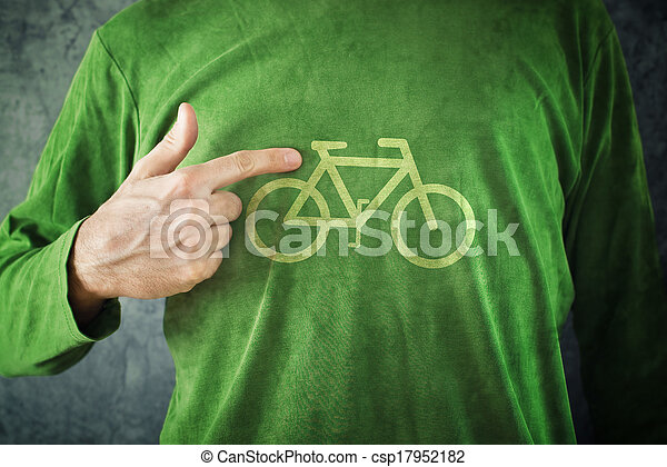 Man pointing to bicycle insignia printed on his green shirt, healthy lifestyle concept. Ride your bike. - csp17952182