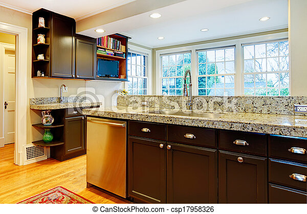 Kitchen design. Black wood cabinets, marble counter top - csp17958326