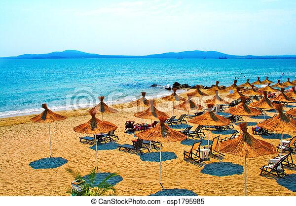 Straw umbrellas on peaceful beach in Bulgaria - csp1795985