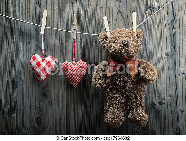 Valentine's Day wallpaper - Teddy Bear hanging with textile hearts - csp17964632