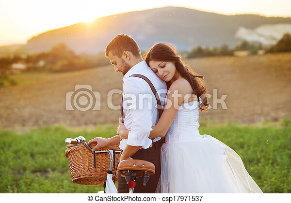 Bride and groom with a white wedding bike - csp17971537