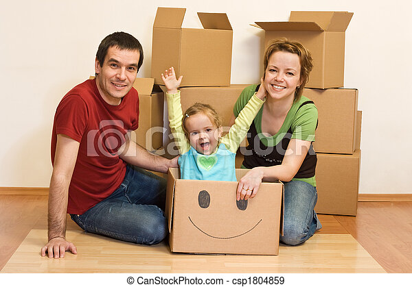 Happy family in their new home sitting on the floor - csp1804859