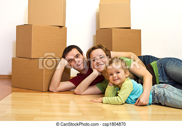 Happy family laying on the floor in their new home - csp1804870