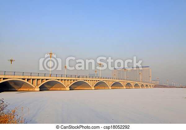 bridges and buildings in the ice river - csp18052292
