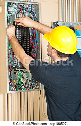 Electrician Working on Electrical Panel - csp1805274